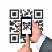 stock photo of qr codes  - Businessman using smartphone with QR - JPG
