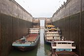 stock photo of dam  - Ships rising in the lock at Three Gorges Dam - JPG