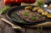 pic of ribs  - Beef rib eye steak with rustic potatoes fresh herbs and tomatoes sprinkled sea salt and herbs - JPG