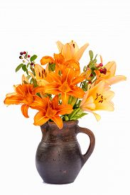 stock photo of asiatic lily  - Asiatic Hybrids orange lilys bouquet in a brown vase isolated on white background - JPG
