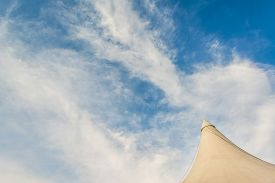 foto of circus tent  - image of circus tent and clear blue sky in background - JPG