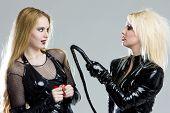 picture of domina  - women in latex with whip - JPG
