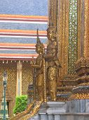 stock photo of mahabharata  - Wat Phra Kaeo and the Grand Palace in gold with warrior statues  - JPG