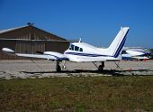 image of cessna  - Charter cessna airplane parked in hangar awaiting boarding - JPG