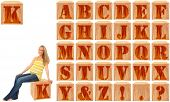 Wood engraved and stained alphabet blocks.  Featuring pregnant woman on Letter K.