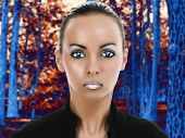 Beautiful young alien woman in fantasy sci-fi portrait in forest. Illustration and photography combi
