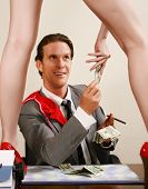 Man paying for erotic dancer show in office.