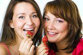 happy couple woman eat strawberry on white