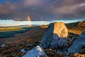 Drake Stone And Rainbow, At Harbottle In Northumberland Which Is A Huge 30 Feet Tall Sandstone Bould poster