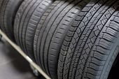 Tires On Sale.new Compact Vehicles Tires Stack. Winter And Summer Season Tires.close Up On All Seaso poster