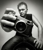 photographer with camera portrait shoot wide angle lens on gray background