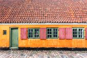Colorful Walls In Traditional Style House In Copenhagen, Denmark. Facade Of Historical Brick Buildin poster