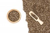 Lot Of Whole Fresh Mottled Chia Seeds In A Scoop With Wooden Bowl Flatlay Isolated On White Backgrou poster