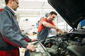 Car Mechanics Working At Automotive Service Center poster
