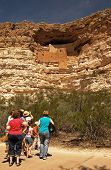 Family viewing the ancient Native American dwelling at Montezuma's Castle National Monument, Camp Verde, Arizona