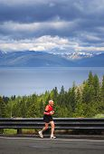 77-year-old man running uphill in a race, Daggett Pass, Lake Tahoe, Nevada