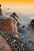 Seascape During Sunset. Beautiful Natural Seascape At Long Exposure. Stones At Foreground poster
