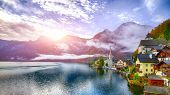 Foggy Autumnal Sunrise At Famous Hallstatt Lakeside Town Reflecting In Hallstattersee Lake. Location poster