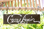 come again phrase on wooden board