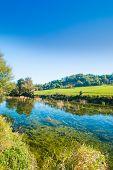 Croatia, Countryside Landscape, River Dobra And Old Fortress In Novigrad, Karlovac County poster