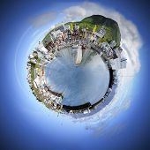 Living in your own world makes life simple and pleasant. A spherical manipulation of a panoramic stitch from 34 images of the arctic fishing village of Husavik, Iceland