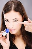 woman holding contact lenses cases and lens
