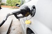 A Gas Pump In A Mini Van At Different Angles poster