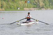 Disabled skiff rower, during a powerful stroke in a rowing regatta