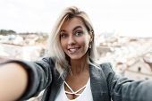 Surprised Funny Beautiful Young Woman With A Smile In A Vintage Suit Doing Selfie On Camera In The C poster