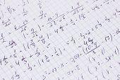 Math, physics and geometry on copybook page closeup