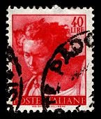 ITALY-CIRCA 1961:A stamp printed in Italy shows image of The Prophet Daniel is one of the seven Old Testament prophet's painted by the Italian High Renaissance master Michelangelo, circa 1961.