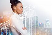 Side View Of Confident Young African American Businesswoman Standing With Crossed Arms And Looking F poster