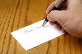 pic of thank you card  - Person writing thank you note with pen on card - JPG