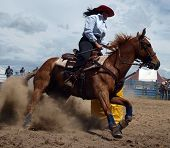 Cowgirl competing in the barrel race