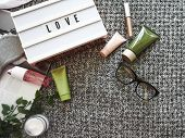 Spa Cosmetic Products On Dark Blanket From Above. Glasses, Magazine, Light Letterbox, Organic Creams poster