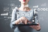 Survey With Business Woman Using A Tablet Computer poster