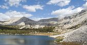 Mountain peaks and high alpine lake; Yosemite Park