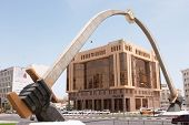 Arch of Swords, Grand Hamad Avenue, Doha, with Qatar National Bank and Qatar Fuel Co building.