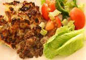 Shepherd's pie and salad, traditional British home-cooking.