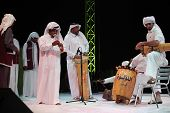 DOHA, QATAR - JANUARY 8: A Qatari folk troupe performs at a cultural event in Doha, Qatar, January 8