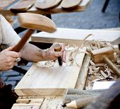 picture of dimples  - The joiner does a dimple in a board working with a chisel - JPG