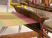 stock photo of loom  - Working on weaving apparatus or loom by Thai people - JPG