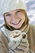 stock photo of hot-chocolate  - Teenage girl in winter hat with cup of hot chocolate - JPG