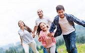stock photo of chase  - Kids having fun with their family outdoors - JPG