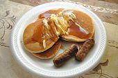 Delicious Pancakes with Syrup and Sausages