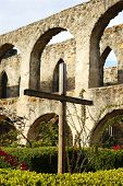 Rugged Cross In Stone Courtyard