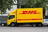 SEVILLE, SPAIN - MAY 15: A DHL delivery truck on the street in Seville, Spain on May 15, 2013. DHL i