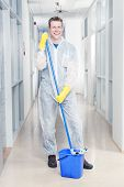 Cleaning office wearing protective overalls