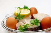 pic of hake  - Lemon slices some eggs an hake and parsley