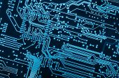 close up background of a blue electronic circuit board